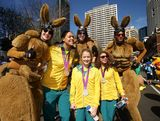 (L-R) Liz Cambridge, Brittany Broben and Jessica Fox pose with performers during the Australian Olympic Team Homecoming Parade in the Sydney CBD on August 20, 2012 in Sydney, Australia.