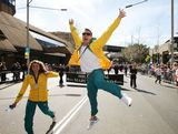 Jessica Fox (L) and Dave Smith (R) celebrate during the Australian Olympic Team Homecoming Parade in the Sydney CBD on August 20, 2012 in Sydney, Australia.