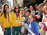 Brittany Elmslie (L) and Emily Seebohm (R) pose with members of the public during the Australian Olympic Team Homecoming Parade in the Sydney CBD on August 20, 2012 in Sydney, Australia.