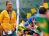 Liz Cambage signs autographs for fans during the Australian Olympic Team Homecoming Parade at Federation Square on August 22, 2012 in Melbourne, Australia.