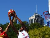 Bo Liu of Chna and Dwayne Lautier-Ogunley of Great Britain contest possession in the Mens Basketball 3x3 match between Great Britain and China during day two of the 2013 Australian Youth Olympic Festival at Darling Harbour on January 17, 2013 in Sydney, Australia.
