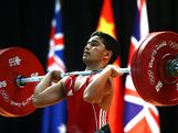 Elson Edward Brechtefeld of Combined Oceania competes in the Men's 62kg Weightlifting during day two of the 2013 Australian Youth Olympic Festival at St Ignatius College on January 17, 2013 in Sydney, Australia.