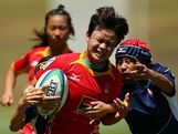 PeiPei Ren of China makes a break against Japan in the Women's Rugby Sevens during day three of the Australian Youth Olympic Festival at St Ignatius College on January 18, 2013 in Sydney, Australia.