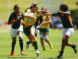 Tayma Terita of Australia takes on the defence in the Women's Rugby Sevens during day three of the Australian Youth Olympic Festival at St Ignatius College on January 18, 2013 in Sydney, Australia.