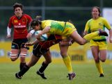 AMSTERDAM, NETHERLANDS - MAY 18:  Tiana Penitani of Australia is tackled by Marta Cabane of Spain during the IRB Women's Sevens World Series match between Spain and Australia at the National Rugby Centre Amsterdam Sportpark de Eendracht on May 18, 2013 in Amsterdam, Netherlands.