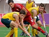 Belgium's Alexander Hendickx vies for the ball with Australia's Flynn Ogilvie and Jake Farrell during a preliminary boys' hockey match of the Singapore 2010 Youth Olympic Games.