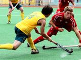 Australia's Ryan Edge tries to fire a shot past Belgium's Benjamin van Dam during the boys' preliminary hockey match of the Singapore 2010 Youth Olympic Games.