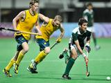 Pakistan's Muhammad Rizwan runs with the ball while Australia's Jordan Willott and Robert Bell chased during the boys' preliminary hockey match between Pakistan and Australia at the Singapore 2010 Youth Olympic Games.