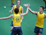 Flynn Ogilvie, Oscar Wookey and Jordan Willott celebrate after beating Chile to advance to he gold medal match.