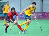 Felipe Tapia of Chile (left) defends the ball from Flynn Ogilvie of Australia during the Singapore 2010 Youth Olympic Games (YOG) boys' preliminary match at Seng Kang Hockey Stadium on Aug 22, 2010.