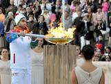 Greek figure skating champion Panagiotis Markouizos lights the cauldron during the Olympic Torch Handover Ceremony, on October 05, 2013 in Athens, Greece.