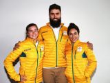 Britt Cox, Anton Grimus & Lydia Lassila try on the Australian Olympic Team podium jackets during the Australian Olympic Committee 100 days to Sochi press conference at Museum of Contemporary Art on October 30, 2013 in Sydney, Australia.