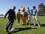 (L-R) Australian Olympic Committee President John Coates kicks the soccer ball around as Le Lam, Mayor of Auburn Council, the boxing kangaroo and athletes Petrina Price and Dani Samuels look on during the 2007 Australian Youth Olympic Festival launch in Sydney.