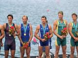 The medal ceremony for the men's without coxwain pair event with the medal placers on the podiium. (From left to right) Silver medal winners Ted Murphy and Sebastian Bea of the USA, Gold medal winners Michel Andrieux and Jean-Christophe Rolland of France and Bronze medal winners Mathew Long and James Tomkins of Australia.