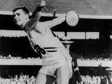 Mexico 1968: Discus thrower Al Oerter of the USA winning one of his four Olympic discus titles, between 1956 and 1968.