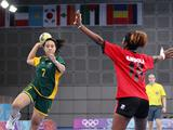 Bella Faasau of Australia (#7) feints to shot but passes in the 5-6 placement match, between Angola and Australia.