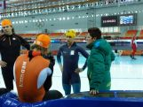 Daniel Greig chats to his coach Desly Hill at official training in the Adler Arena in Sochi,