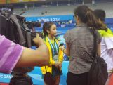 Youth Olympic Table Tennis player Vy Bui gets interviewed by Nanjing TV at the Wutaishan Sports Gymnasium.