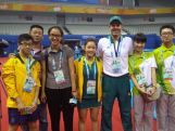 Youth Olympic Table Tennis players Dominic Huang, Vy Bui and coach Jens Lang hang out with Nanjing TV and YOG Volunteers at the Wutaishan Sports Gymnasium.