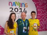Youth Olympic Modern Pentathletes Marina Carrier, Max Esposito and coach Daniel Esposito pose for a photo after an interview in Nanjing.