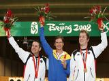 (L-R) Ralf Schumann of Germany, silver, Oleksandr Petriv of Ukraine, gold, and Christian Reitz of Germany, bronze, all celebrate after receiving their medals in the Men's 25m Rapid Fire Pistol Final at the Beijing Shooting Range Hall on Day 8 of the Beijing 2008 Olympic Games on August 16, 2008 in Beijing, China.
