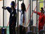 (L-R) Silver medallist Gundegmaa Otryad of Mongolia, bronze medallist Munkhbayar Dorjsuren of Germany and gold medallist Chen Ying of China compete in the Women's 25m Pistol shooting.