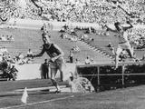 Los Angeles 1932: Volmari Iso-Hollo of Finland leads the field over the water jump during the 3,000m steeplechase event and goes on to take the gold medal, Thomas Evenson of Great Britain the silver and Jozeph McCluskey of the USA the bronze.