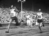 London 1948: Jamaican athlete Arthur Wint equalling the world record to win gold in the men's 400m final. Fellow Jamaican Herbert McKenley, right, finished second to claim the silver medal.