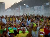 RIO DE JANEIRO, BRAZIL - JUNE 23:  Brazil fans cheer after Brazil scored its first goal while watching a live broadcast of the Brazil-Cameroon match at the FIFA Fan Fest on Copacabana Beach on June 23, 2014 in Rio de Janeiro, Brazil. Brazil won the match 4-1.