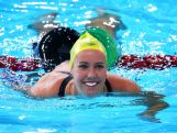 Emma McKeon of Australia celebrates winning the gold medal in the Women's 200m Freestyle Final at Tollcross International Swimming Centre during day one of the Glasgow 2014 Commonwealth Games on July 24, 2014 in Glasgow, Scotland.