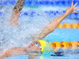 Mitch Larkin of Australia competes in the Men's 100m Backstroke Semi-final 2 at Tollcross International Swimming Centre during day one of the Glasgow 2014 Commonwealth Games on July 24, 2014 in Glasgow, Scotland.