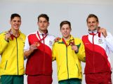 Gold medallist Chris Walker-Hebborn (2ndL) of England poses with silver medallist Mitch Larkin of Australia and joint bronze medallists Liam Tancock of England and Josh Beaver of Australia during the medal ceremony for the Men's 100m Backstroke Final at Tollcross International Swimming Centre during day two of the Glasgow 2014 Commonwealth Games on July 25, 2014 in Glasgow, Scotland.