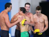 James Magnussen of Australia celebrates with team mates Cameron McEvoy, Matt Abood (L) and Tommaso D'Orsogna (R) after winning the gold medal in the Men's 4 x 100m Freestyle Relay Final at Tollcross International Swimming Centre during day two of the Glasgow 2014 Commonwealth Games on July 25, 2014 in Glasgow, Scotland.