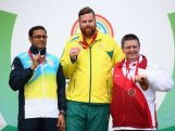 Gold Medallist Daniel Repacholi of Australia (C), Silver Medalist Michael Gault of England (R), and Bronze Medalist Prakash Nanjappa of India (L) celebrate on the podium after winning their medals in the Men's 10m Air Pistol Shooting at Barry Buddon Shooting Centre during day three of the Glasgow 2014 Commonwealth Games on July 26, 2014 in Carnoustie, United Kingdom.