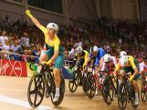 Annette Edmondson of australia celebrates as she crosses the line to win gold in the Women's 10km Scratch finals at Sir Chris Hoy Velodrome during day three of the Glasgow 2014 Commonwealth Games on July 26, 2014 in Glasgow, United Kingdom.