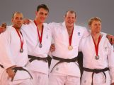 (L-R) Bronze medallist Jake Andrewartha of Australia, Silver medalist Ruan Snyman of South Africa, Christopher Sherrington of Scotland and Mark Shaw of Wales pose on the podium during the medal ceremony for the Men's +100kg Judo final at the Scottish Exhibition and Conference Centre Precinct during day three of the Glasgow 2014 Commonwealth Games on July 26, 2014 in Glasgow, United Kingdom.