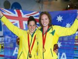 Gold medallist Emily Seebohm (R) of Australia poses with bronze medallist Belinda Hocking of Australia after the medal ceremony for the Women's 100m Backstroke Final at Tollcross International Swimming Centre during day three of the Glasgow 2014 Commonwealth Games on July 26, 2014 in Glasgow, Scotland.