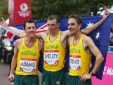 Gold medallist Michael Shelley (C) celebrates with teammates Liam Adams (7th) (L) and Martin Dent (19th) on the city marathon course during day four of the Glasgow 2014 Commonwealth Games on July 27, 2014 in Glasgow, Scotland.