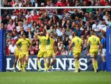 Australia players celebrate their last minute try in the quarter final match between Australia and Wales during the Rugby Sevens at Ibrox Stadium during day four of the Glasgow 2014 Commonwealth Games on July 27, 2014 in Glasgow, United Kingdom.