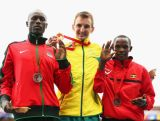 (L-R) Silver medallist Stephen Chemlany of Kenya, gold medalist Michael Shelley of Australia and bronze medalist Abraham Kiplimo of Uganda stand on the podium during the medal ceremony for the Men's Marathon at Hampden Park Stadium during day four of the Glasgow 2014 Commonwealth Games on July 27, 2014 in Glasgow, Scotland.