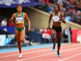 Morgan Mitchell of Australia and Catherine Eke of Sierra Leone compete in the Women's 400 metres heats at Hampden Park Stadium during day four of the Glasgow 2014 Commonwealth Games on July 27, 2014 in Glasgow, Scotland.
