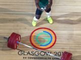 Francois Etoundi of Australia celebrates a successful lift on his way to a bronze medal in the Men's Weightlifting 77kg category at Scottish Exhibition And Conference Centre during day four of the Glasgow 2014 Commonwealth Games on July 27, 2014 in Glasgow, United Kingdom.