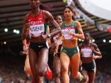 Janeth Jepkosgei Busienei of Kenya and Katherine Katsanevakis of Australia compete in the Women's 800 metres heats at Hampden Park during day seven of the Glasgow 2014 Commonwealth Games on July 30, 2014 in Glasgow, United Kingdom.