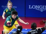 Hu Heming and Melissa Tapper of Australia compete with Anthony Ringui and Jinita Azad Kumar Shah of Kenya in the mixed doubles table tennis at Scotstoun Sports Campus during day seven of the Glasgow 2014 Commonwealth Games on July 30, 2014 in Glasgow, United Kingdom.