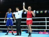 Shelley Watts of Australia celebrates after defeating Isabelle Ratna of Mauritius in the Women's Fly 57-60kg Division Boxing quarterfinals at Scottish Exhibition And Conference Centre during day seven of the Glasgow 2014 Commonwealth Games on July 30, 2014 in Glasgow, United Kingdom.
