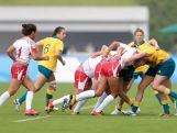 Gibson Kellie (R) of Australia competes in the Rugby Sevens on day one of Nanjing 2014 Summer Youth Olympic Games at Nanjing sports park rugby field on August 17, 2014 in Nanjing, China.