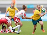 Gibson Kellie (R) of Australia is tackled by Amira Letaief of Tunisia in the Rugby Sevens on day one of Nanjing 2014 Summer Youth Olympic Games at Nanjing sports park rugby field on August 17, 2014 in Nanjing, China.