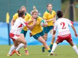 Gibson Kellie (C) of Australia is tackled by  Khouthar Nasr and Faten Dorai of Tunisia competes in the Rugby Sevens on day one of Nanjing 2014 Summer Youth Olympic Games at Nanjing sports park rugby field on August 17, 2014 in Nanjing, China.
