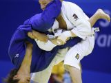 Bryan Jolly of Australia (Blue) and Jorre Verstraeten of Belgium (White) compete in the Men 66kg Quarterfinals on day one of Nanjing 2014 Summer Youth Olympic Games at Longjiang Gymnasium on August 17, 2014 in Nanjing, China.