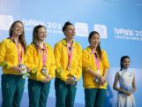 Bronze medallists Amy Forrester, Ella Bond, Brianna Throssell and Ami Matsuo of Australia celebrate after the Women's 4x100m Medley Relay Final on day two of Nanjing 2014 Summer Youth Olympic Games at Nanjing OSC Natatorium on August 18, 2014 in Nanjing, China.